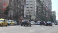 Travel inside big town, cars running fast on large boulevard, clear sunny day Stock Footage
