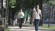People commuting, stepping on sidewalk car traffic view on road, urban lifestyle Stock Footage