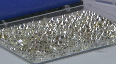 Tray of scores of sparkling diamonds Stock Footage