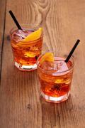 Spritz aperitif, two orange cocktail with ice cubes Stock Photos