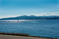 Port orchard. puget sound and olympic mountains  on sunny day Stock Photos