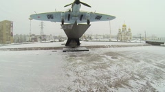 Monument of attack-plane IL-2 is on round square Stock Footage