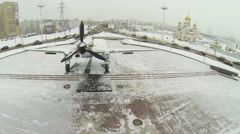 Soviet battle plane IL-2 on round square with traffic Stock Footage