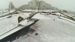 Soviet attack-plane IL-2 on round square with traffic Stock Footage