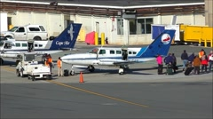 Cape Air passengers, small prop plane Stock Footage