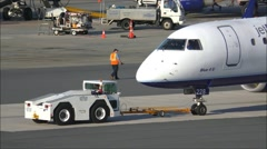 JetBlue airplane tow tug Stock Footage