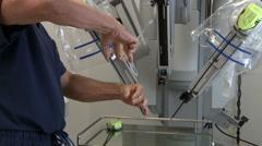 Surgeon shows DaVinci Insert Stock Footage