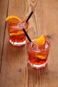 spritz aperitif, two orange cocktail with ice cubes - stock photo