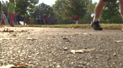 Kids running on school playground low angle day Stock Footage