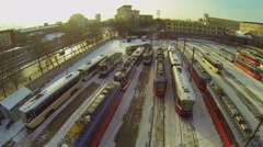 Lot of trams parked in depot Rusakov near river embankment - stock footage