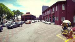 Retro look time lapse of red buildings in old Melaka with traffic. Malaysia. 4K Stock Footage