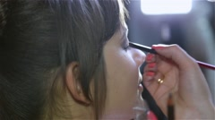Master in the beauty salon to apply makeup for eyes model Stock Footage