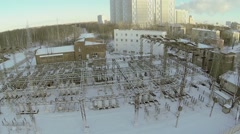 Electricity station near dwelling houses at winter day Stock Footage