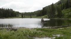 Man fishing Cove Lake in remote Utah mountains-HD P-2584 Stock Footage