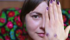 Girl covers his face shows up and manicure Stock Footage