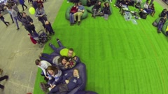 Visitors sit in chair bags during Geek Picnic European festival Stock Footage