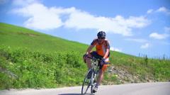 Biker on a road Stock Footage