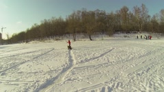 Mother with her son skates by big word PLAY on snow at icy pond Stock Footage