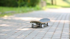 Empty skateboard drive along paving stone alley in the park Stock Footage