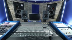 Stock Video Footage of Modern recording studio with equalizer, speakers and keyboards