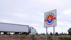 Arizona Sign with Semi Truck - stock footage