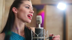 Close up of woman singing to microphone in Recording Studio Stock Footage