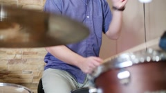 Hands of young male drummer playing in modern recording studio Stock Footage