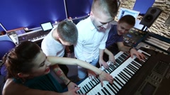 Musical group play keyboard in recording studio Stock Footage