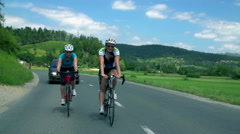 Man and woman cycling together Stock Footage