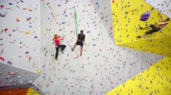 People involved in climbing in climbing gym Bigwall Stock Footage