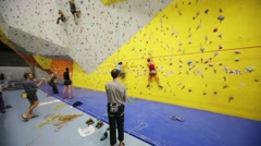 Climbers in climbing gym Bigwall on Savelovskaya. Stock Footage