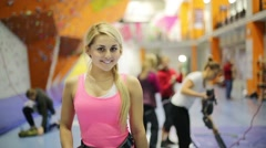 Portrait of smiling girl in undervest in climbing gym center Stock Footage