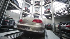New Volkswagen car on lift in tower for storage and presentation Stock Footage