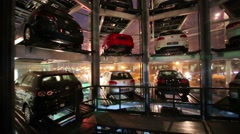 Cars in tower to store in Volkswagen Center Varshavka Stock Footage