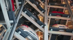 Bottom view of cars on floors of tower to store Stock Footage
