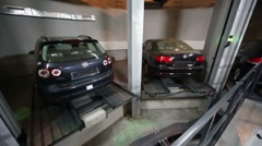 Many cars and white car with opened door stand in garage Stock Footage