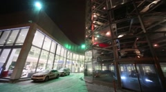 Tower and building with glass wall of Volkswagen Center Warshavka Stock Footage