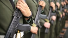 Hands and chests of soldiers in uniforms with machine guns Stock Footage
