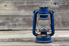 Old dirty lantern on aged wood Stock Photos