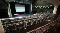 Auditorium with chairs, handrails and stage in hall Stock Footage