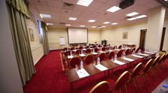 Screen in empty conference hall with red carpet on floor - stock footage