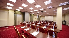 Turning off lights in meeting hall with many tables and chairs Stock Footage