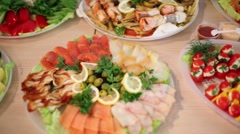 Many plates with different cold appetizers on table Stock Footage