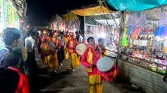 Musical procession of a religious group in a village fair in India. Stock Footage