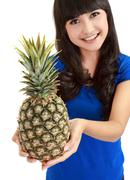 Stock Photo of portrait of a beautiful caucasian woman with pineapple