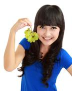 Stock Photo of beautiful woman holds grapes