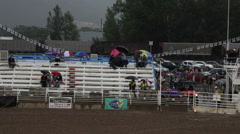 Rodeo rain train passing stands HD Stock Footage