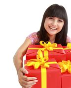Stock Photo of woman with many gift boxes and bags