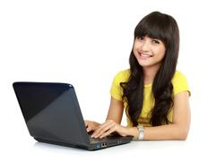 Stock Photo of beautiful smiling woman with laptop
