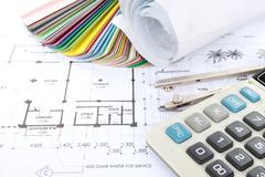 architect concept of design and project drawings - stock photo